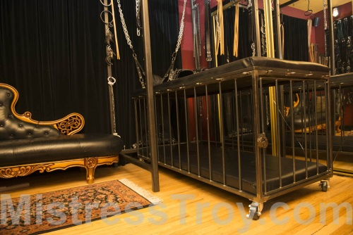 MISTRESS TROY FemDomme NYC has a dungeon with leather BDSM equipment