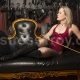 Mistress Troy in leather ballet boots lounges in her New York City dungeon