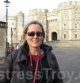 Mistress Troy employs comprehensive tourist gear at Windsor Castle, England