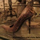 Mistress Troy discovers high-heel shoes in an Italian blacksmith's wrought iron workshop